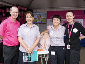 Participants learn about breast checks for breast cancer awareness.