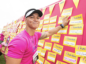 Participant adds his tribute card the RACQ's Tribute Wall.