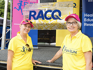 RACQ event staff get ready to pick the lucky winner of the Race Bib competition.